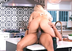 Sexy blonde anally rides lover's BBC in the kitchen