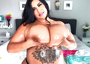 Hot BBW oils their way immense breast and plays with 'em